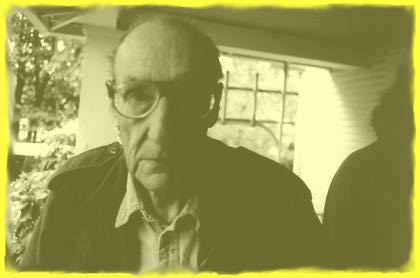William Burroughs on his porch