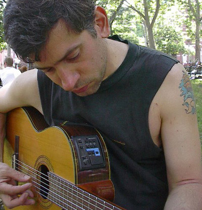 Marc Eliot Stein playing guitar in Washington Square Park